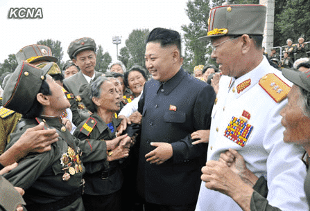 Kim Jong Un Has Photo Session with War Veterans and Commanding Officers