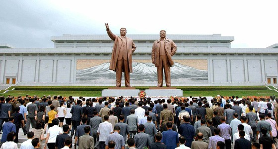 Floral Baskets Laid before Statues of Kim Il Sung, Kim Jong Il